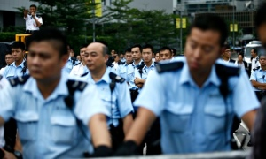 Police secure the entrance of the office of Hong Kong's chief executive CY Leung