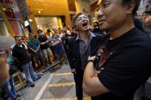 UKReuter: A man opposing pro-democracy protesters blocking the streets of Mongkok shopping district shows his anger in Hong Kong October 23, 2014. REUTERS/Damir Sagolj